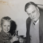 Michael Sedgwick presenting Celvin Smith with an award