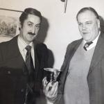 Michael Sedgwick presenting Alec Burt with an award