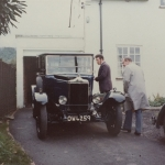 Couple of chaps with their car