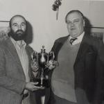 Michael Sedgwick presenting  Derek Leach with an award