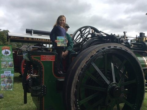 Olivia with her Torton Tales book on Victoria